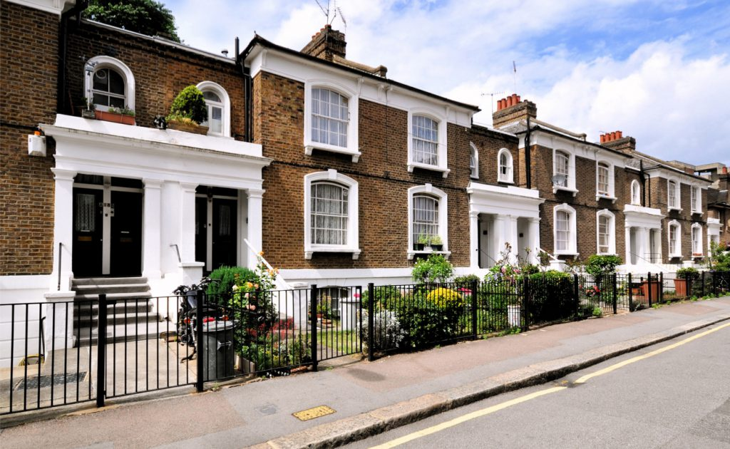 a row of neat face brick homes in London