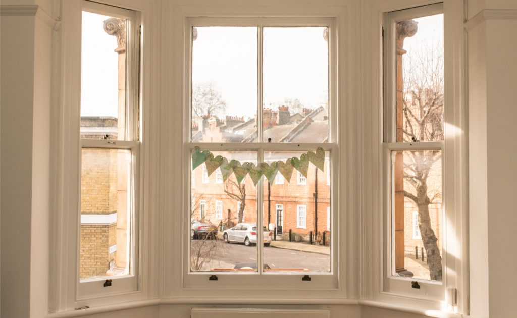 large bay window looking out onto London street