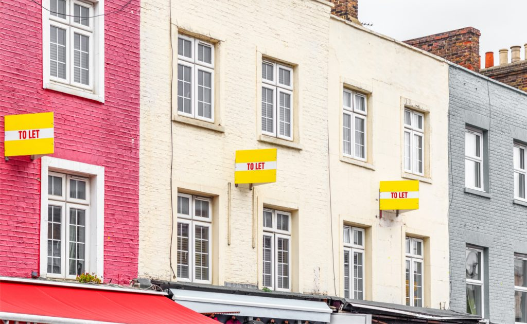 row of houses with to let signs outside