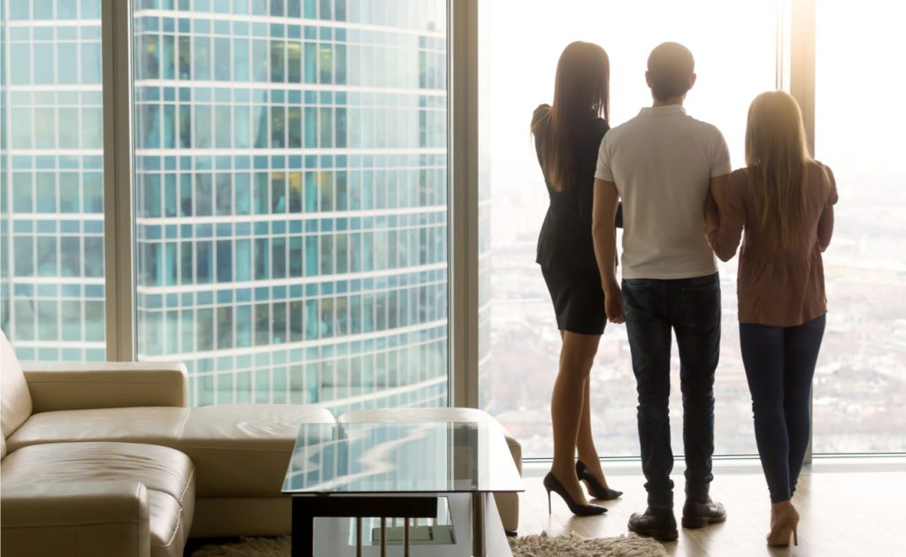 estate agent showing young couple high rise London apartment