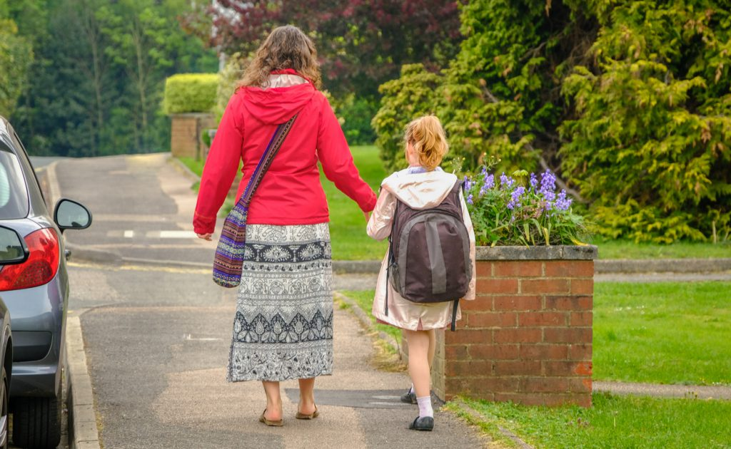 mother walking her young daughter to school