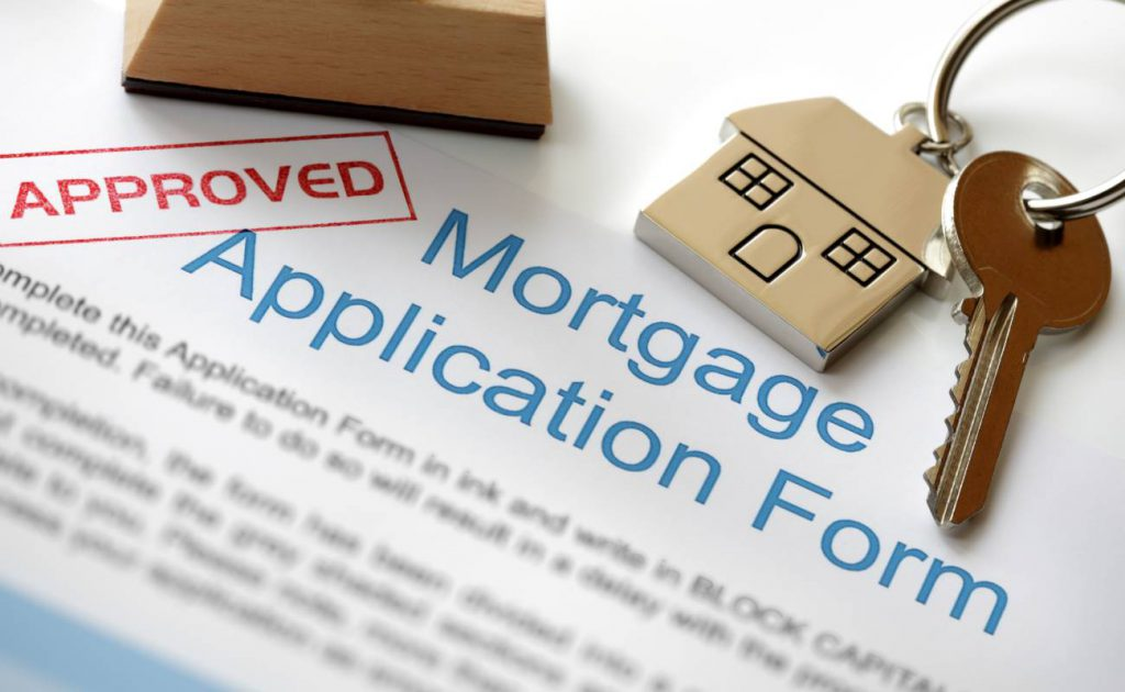 mortgage application form with approved stamp on it