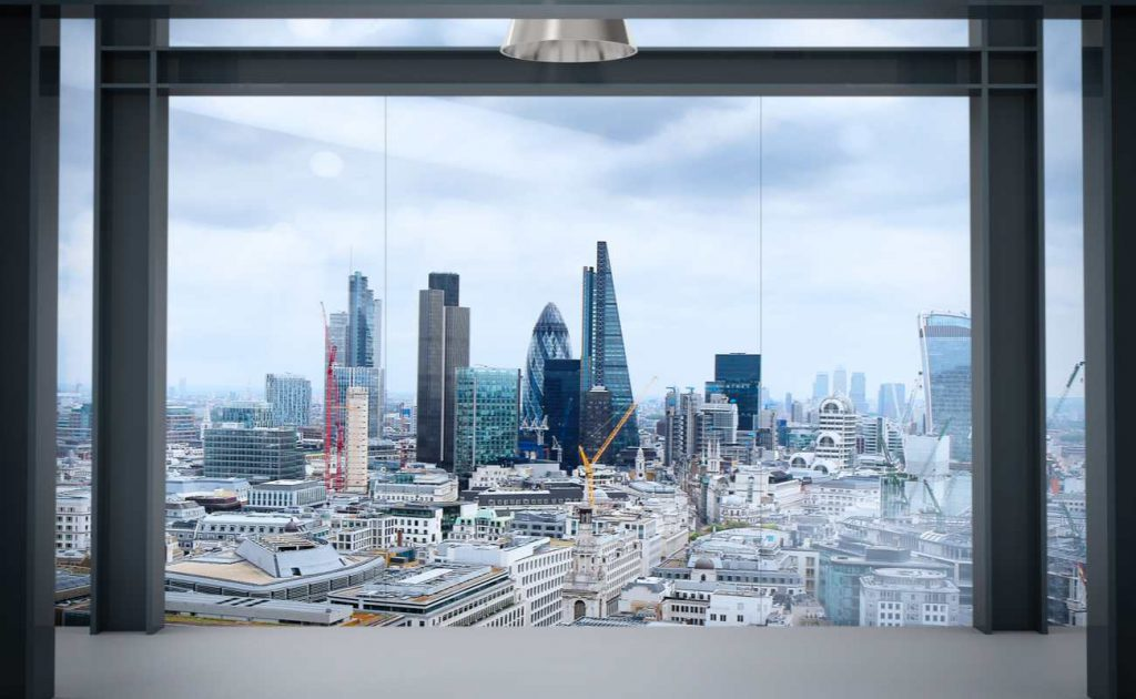 View through large apartment window of London city skyline